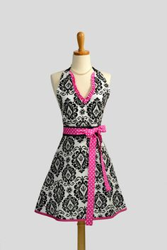 Womens Halter Hostess Apron / Handmade Retro Apron in White and Black Damask Trimmed in Hot Pink and White Dots Oooh la la. $37.00, via Etsy.