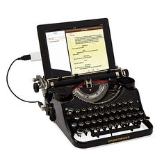 USB TYPEWRITER... if I had an iPad... and extra money I'd snap this up in a heartbeat