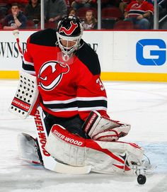 Martin Brodeur Photos - Goalie Martin Brodeur of the New Jersey Devils stops a shot by the Buffalo Sabres during the first period of an NHL hockey game at Prudential Center on January 2012 in Newark, New Jersey. - Buffalo Sabres v New Jersey Devils Nhl Hockey Teams, Hockey Games, Hockey Players, Ice Hockey, Martin Brodeur, East Rutherford, Goalie Mask, Nhl News, New Jersey Devils
