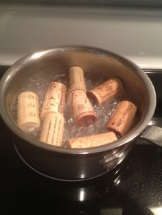 Great to know before doing any crafts with corks! Before cutting corks boil them in water for around 10 minutes. This will stop them from crumbling or cracking when you cut or carve into them.