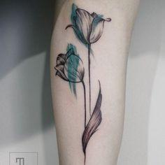 http://tattoomagz.com/colorful-tulip-tattoos/black-and-blue-tulip-tattoo/