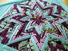 Folded star potholder. (Tutorial here: http://www.modabakeshop.com/2011/09/fancy-folded-star-pot-holder.html#more)