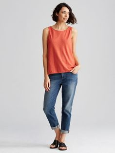 Eileen Fisher. Orange top, relaxed fit. With jeans, sandals, flit flops