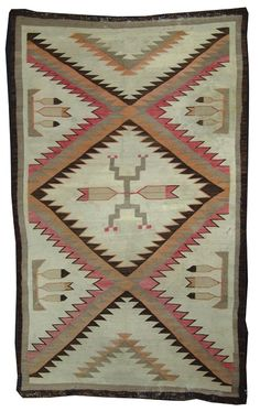 https://www.liveauctioneers.com/item/34446578_navajo-rugweaving