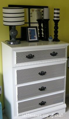 Dress up an old dresser by applying a fresh coat of paint and the new patterned duct tape to the drawer fronts!