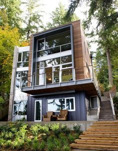 THIS is what a shipping container house looks like, when dolled up. You can do less windows of course and you can do it in all different ways. They're really gorgeous. Economically friendly, a self sustaining lifestyle. Nick's ideas are amazing, as long as we can follow through.