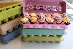 Love this: Bright-colored egg cartons to hold mini cupcakes! The clear plastic egg containers would work great too.