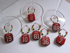 Chicago Blackhawks Wine Charm Set by TaylenandKatie on Etsy, $35.00  Hockey games at my future house will now be classier with these on everyone's wineglass. I have dibs on Sharpy & Tazer though! (ok, and Seabs and Hjammer!)