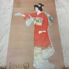 Vinage Japan Airlines geisha poster with artwork by Shoen Uemura called Jonomai. Beautiful depiction of a geisha in full costume holding a fan as if ready to perform. This is an original vintage poster, not a reproduction. Estimated to be made in the 1960s. Super collectible and great for retro home decor. Dimensions of this poster are 39 inches x 24 inches. This poster is in good vintage condition. There is some tape and damage as shown in the collage photo #4, also discoloration on the…