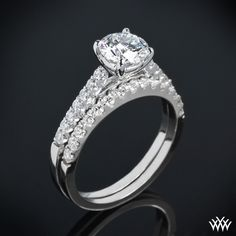 Delicately designed, the 'Petite Open Cathedral' Diamond Wedding Set is perfect for those who love simple elegance. The 'Petite Open Cathedral' Diamond Engagement Ring is adorned with 14 Round Brilliant Diamond Melee (0.20ctw; G/H VS), while the  'Petit...