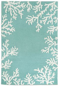 Soft off-white coral images makes up the border of this new Coral Bordered Aqua beach house area rug. A classic coastal color to brighten up any room in your home!