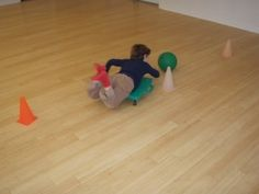 """Scooter boards are a fun way of """"waking up"""" a child's proprioceptors and when these are """"awake"""" their ability to focus on other tasks increases. This woman's website also provides OTs with other great ideas/resources"""