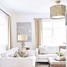 White, Cream and Gold Living Room with dramatic ceiling light fixture - Erica Cook