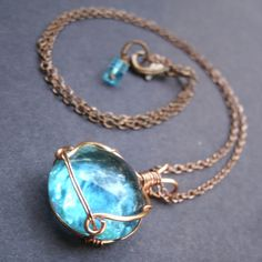 Copper Wire Wrapped Aqua Glass Marble Pendant Necklace. $35.00, via Etsy.