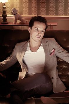I'm madly in love with Andrew Scott. He could be gayer than a unicorn riding a rainbow through a happy little meadow and I wouldn't care. I mean, look at him.