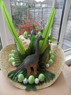Dinosaur Easter Bonnet. Buy a large size straw hat, then decorate it with dinosaurs, Easter eggs and leaves.