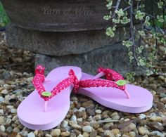 Light pink Flip Flops with pink and white  ribbon hand wrapper, with green button. Visit us at www.facebook.com/yarnandwire