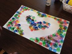 Tape, Stamp, & Reveal {an Easy, Fine Motor Craft} by theautismhelper.com
