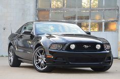 The 2014 Ford Mustang GT is a new car you can afford for around the price of Pi. $31,415 #PiDay