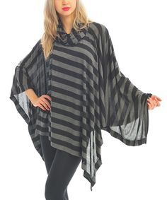 Never+losing+its+pleasing+look,+this+classic+poncho+will+stay+on+point+from+one+season+to+the+next.+The+stripe+print+and+cowl+neck+pair+for+modern+appeal.