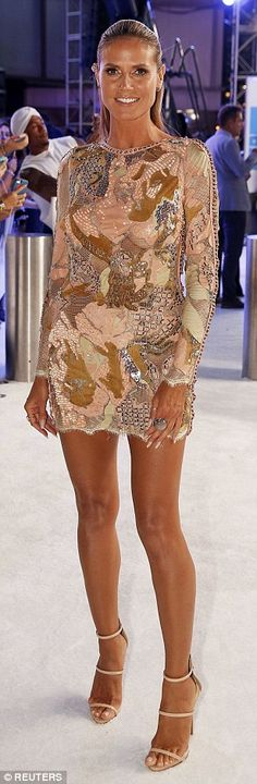 Legs eleven...out of ten! Heidi Klum showed off her slim pins in a short embroidered number