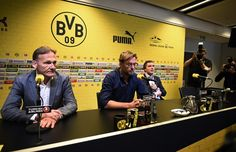 Dortmund's head coach Juergen Klopp (C), Dortmund's CEO Hans-Joachim Watzke (L) and Dormund's sports director Michael Zorc (R) give a press conference on April 15, 2015 in Dortmund, western Germany, to announce that Klopp will step down as coach of German first division Bundesliga football club Borussia Dortmund. Klopp will quit as head coach at the end of the season after seven years in charge and two German league titles.