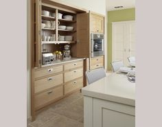 Appliance Cupboard for the left side of the range with outlets and counter surface inside.