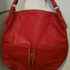 Dooney & Bourke Purse Red leather!! Short shoulder strap so sits under your arm. This has some minor scratches which should come out with some leather conditioner. This bag is big and all zippers work well. Main compartment is a zip close and there is an additional zipped pocket inside with the cell phone pockets. Dooney & Bourke Bags Shoulder Bags
