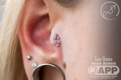 Double tragus piercing by APP member by Lou Quinno at Piercing Experience in Atlanta, GA.