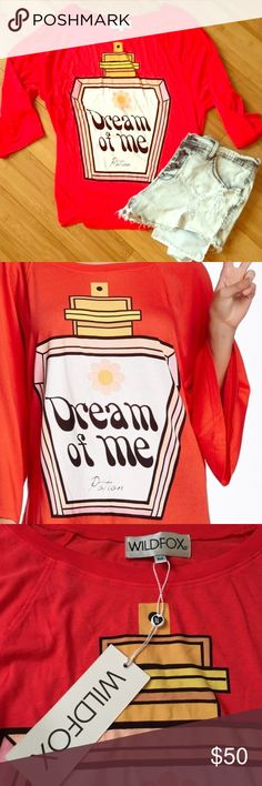 """WILDFOX DREAM OF ME POTION RAGLAN TEE NWT. Never worn. Red. Wildfox """"Dream Of Me Potion"""" oversized raglan graphic tee. No flaws. Can probably fit L to XL, it's pretty oversized. 3/4 sleeves. Super soft signature wildfox material. Please view photos and ask questions before purchase. No trades. Thank you !! Wildfox Tops Tees - Long Sleeve"""