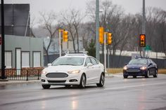 Ford Fusion Hybrid autonomous vehicles with their four current Velodyne sensors WESTLAND, Mich. –– Ford is tripling its autonomous vehi. Ford Fusion, Google Car, Google News, Michigan, Movie Projector, Auto News, Smart Car, Automobile Industry, Self Driving