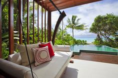 Hotels  White  Sofa  Red  Pillow  Wooden  Floor  Wooden  Ceiling  Sea  View  Swimming  Pool  In  Niyama  Hotel  In  The  Maldives  Show  Amazing  Landscape  Blue  Skies  And  Blue  Ocean Sweet Deluxe Hotel in Maldives with a Tailored Ambience Suited for the Modern Traveler