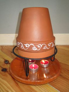 DIY:: Flower Pot Heater ~ Gives a lot of heat, costs about nothing, easy to make and it looks pretty nice, too! Clay/Terracotta pots absorb the thermal energy of the candles and convert it into radiant space heat. Reaches temperatures of 160F to 180F. Heater stays hot for hours. use caution, the inner chamber can reach 500F. Heats a small area very effectively. uses 1 to 3 candles or more. How To @: http://www.youtube.com/watch?v=nzKbFzUEWkA