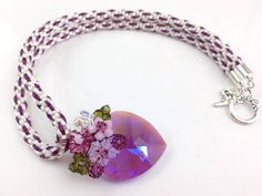 This is amethyst crystal heart pendant floral design with Plum and ivory colours Kumihimo necklace. - amethyst crystal heart pendant floral design
