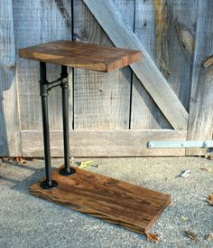 This rustic industrial style end table is a great way to add a little support for a drink, book and/or computer at your favorite chair or sofa. The table also features a tee handle in the framework to make moving to your desired spot a breeze. Made with sustainable plank lumber and a heavy duty black iron pipe framework. Overall measurements- 24 wide X 27 3/8 tall X 11 1/4 deep Table top is 11 1/4 x 16 7/8  There is 24 3/8 between the floor support and the table ...