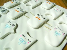 Work in progress : Petits Mignons, polymer clay pendants and brooches.