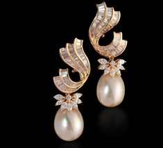 Diamond earring with south sea pearls set in 18k yellow gold. Farah Khan