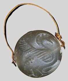 Greek Island gem 700BC-600BC 600-700 BC Shape: circular. Depiction: Water bird, possibly a swan. In the field a snake.