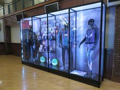 Display cases showing off all the DOTA gear at The International DOTA 2 Championships in Seattle.