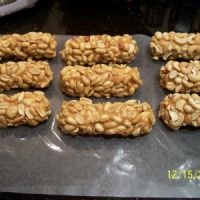 Queen Anne Salted Peanut Caramel Nougat Rolls Recipe loved these as a kid Sweets Recipes, Candy Recipes, Great Recipes, Desserts, Healthy Recipes, Nut Roll Recipe, Salted Nut Rolls, Fudge, Healthy Snacks
