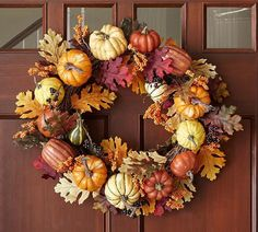 Harvest Pumpkin Wreath Colorful faux pumpkins and gourds are interspersed among realistic oak leaves and berries. Afflink.
