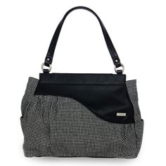 *Miche Canada* Available through your local Miche Home Party Representative. Neisha for Prima Bags just might be your new favorite cold weather Shell! Classic houndstooth fabric in a miniature pattern is flecked with the tiniest hints of silver—giving it a little touch of surprising sparkle. The pièce de résistance is the dramatic black faux leather wave detail across the top. Be still my heart—this gorgeous Shell is perfect with just about any outfit!