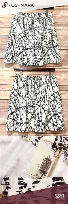 """Francesca's abstract print skirt Lightweight and pretty skirt from Francesca's. Gently worn, no condition issues. Lined. Pockets. Elastic waist. Poly. Length is 18.5"""". Waist is 14.5"""" flat and unstretched. Francesca's Collections Skirts"""