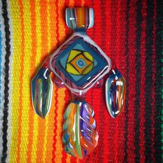 Current AUCTION: Amazonian Amulet- a pendant inspired by Peruvian textiles.  I'll be calling this pendant auction sometime today.  Please bid on the original auction post.  Thanks! #AAAglass #amazon #pendantsofig #glassofig #highfashion #higherfashion #textile #featherjewelry