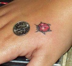 small ladybug tattoo image