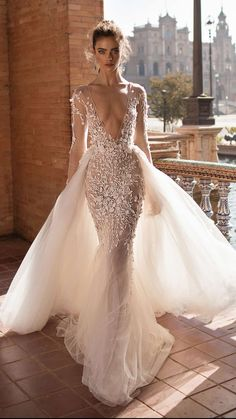 2018 Wedding dresses by Berta Bridal with a plunging v-neck and embellishment. #weddingdresses #weddinggowns