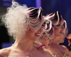 Models pose at the biannual OMC Hairworld World Cup, which started on Saturday and finishe...