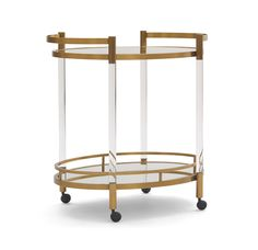 Always be party-ready with this petite oval bar cart by Mitchell Gold Bob Williams, a chic vintage statement in acrylic and satin brass. Contemporary Bar Carts, Contemporary Furniture, Hamptons Living Room, Huntington Homes, Bar Cart Styling, Dining Room Bar, Mitchell Gold, Classic House, Modern Classic