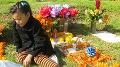 During Day of the Dead family and friends go to the gravesite of their loved one, and celebrate.