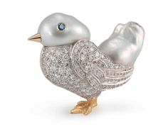 Seaman Schepps Chick Brooch with sapphire, diamond set in white and yellow gold and two large baroque pearls. Adorbs.